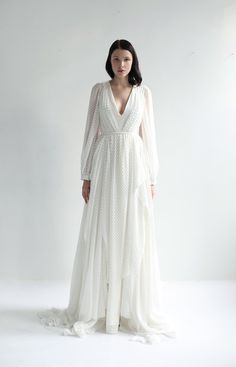 Long sleeve V neck gown in light ivory silk/cotton bow-dotted chiffon. Mid V neck bodice fully lined and draped in front, with open back December Wedding Dresses, Garden Wedding Dresses, Black Wedding Dresses, Wedding Dresses Plus Size, Princess Wedding Dresses, Plus Size Wedding, Unique Dresses, Boho Wedding Dress, Vintage Dresses