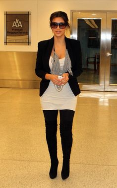 Kim Kardashian wearing Louis Vuitton Evidence Sunglasses Christian Louboutin Monica Over The Knee Boots  Arriving in Miami September 26 2010