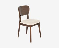 Dania - Our Juneau dining chair has a light, mid century look with a cream fabric seat and tapered legs. Constructed from solid beech and a walnut veneer frame. Understated, classic design at a great price.