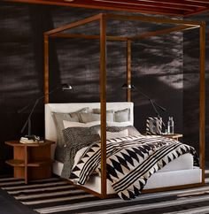 Serene bedroom with spa-like tranquility from Ralph Lauren Home's Black Palms Collection