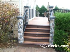 This is a Trex Transends deck with a double picture frame with Deckorators stone columns with accent lights at each columns shining up Deck Stairs, Deck Railings, Railing Ideas, Creative Deck Ideas, Deck Framing, Double Picture, Deck Pictures, Stone Pillars, Deck Construction