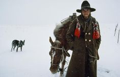 Sam Abell / National Geographic  #Cowboy, horse and dog in the snow