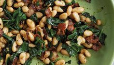 Creamy beans, salty pancetta, and bright color from the spinach -- a winning combination on the fly!