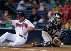Brandon Beachy gets a base hit and drives in Chipper Jones!