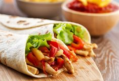 Serve with low‑fat natural yoghurt or sour chicken green red small g of low‑fat grated tortilla tablespoon of chilli powder teaspoon of vegetable oil Chicken Pita Wrap Recipe, Chicken Recipes, Chicken Burritos, Chicken Fajitas, Tortillas, Cheddar, Sour Cream Ingredients, Turkey Tenderloin, Kitchen Aid Recipes