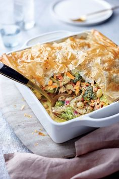 Turkey, Broccoli, and Phyllo Pie   A healthy dose of warm, fragrant curry powder turns a ho-hum post-holiday casserole into exactly what we want to eat this time of year. We ditch the pastry dough for a flaky, golden phyllo crust—a nice alternative to the pies and potpies you may be wary of by now. Don't fret about getting the phyllo topper to fit snugly in the baking dish; any overhang will become delightfully crisp in the oven. Thawed phyllo can be finicky: Unroll very carefully, and keep