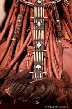 Africa | Details from a Himba woman; ochre and hair ornaments.  Opuwo.  Namibia | ©Wendy Kaveney