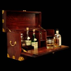 Product Details:  Hand crafted Croco Leather & Rosewood drinks cabinet with a lift out tray which doubles as a flap to hold in place 6 glasses. This case is the most luxurious cabinet you will find for use in the field.   Dimensions:  Length: 9' Depth: 10' Height: 17.5'