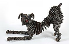 Israeli artist Nirit Levav Packer solders and welds discarded bicycle parts together to create adorable dog sculptures for her series titled HOW! WOW! The former fashion designer specializing in bridal gowns decided to switch gears and experiment with more durable forms of art.