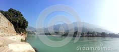Photo about A panoramic image of the Ram Jhula bridge in the foothills of the Himalayas in Rishikesh Uttarakhsnd India. Image of rishikesh, india, ganges - 82616923 Panoramic Images, Rishikesh, Bridge, India, River, Stock Photos, Celestial, Outdoor, Outdoors