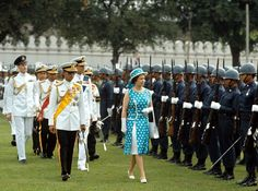 1972: Queen Elizabeth II reviews an honour guard with King Bhumibol Adulyadej during her visit to Thailand