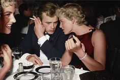 James Dean Seated at Dinner with Ursula Andress 1955 Hollywood notables during a charitable affair at Ciro's, a famous Hollywood nightclub Corbis Archive Old Hollywood Actors, Classic Hollywood, Hollywood Glamour, Willie Nelson, Hollywood Nightclubs, Divas, Good Old Movies, James Dean Photos, Ursula Andress
