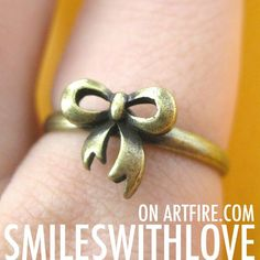 $7 Adjustable Bow Tie Ribbon Ring in Bronze