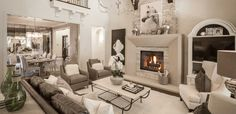 A stacked-stone fireplace with a gorgeous mantle in a matching cream tone - Regency Park // Flower Mound, TX // Huntington Homes // Plan 3970
