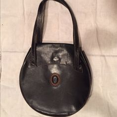 Trussardi Black Leather Purse Unusual black leather Trussardi shoulder bag purse; boho style. The leather is hard so it retains its shape. All stitching is in good shape. Purse has some scratches from normal wear. Trussardi Bags Shoulder Bags