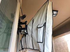 Beige Outdoor Tv Cover 32 Inch Mounted On The Full Motion Articulating Wall Mount