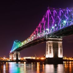 Montreal's Jacques Cartier Bridge lit up like a rainbow for the city's birthday. Quebec Montreal, Old Montreal, Montreal Ville, Jacques Cartier, Toronto, Dream Vacations, Vacation Spots, Canada 150, Largest Countries
