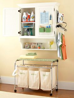 wall hung cabinet + laundry cart on wheels = instant laundry station Laundry Station, Laundry Cart, Laundry Storage, Laundry Room Organization, Diy Storage, Laundry Center, Organization Ideas, Laundry Closet, Utility Closet