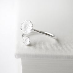 A delicate meadow wildflower wrap ring.