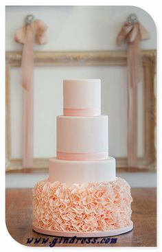 ruffle tier classic wedding cake in pastel peach colour, perfect for a modern sophisticated wedding theme