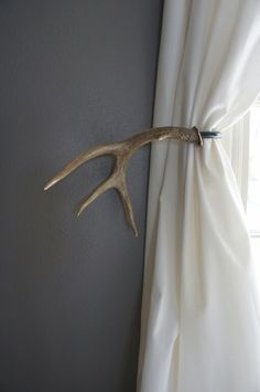 Antler Curtain Tie Back Holdback Cabin Decor by UpscaleDownhome Great idea as I actually own antlers and am not sure what to do with them!