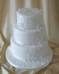 White Fondant And Snowflake Lace-like Detail Wedding Cake - wonderful for a winter wonderland wedding affair