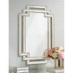 Beaded details line the outer and inner border of this stylish openwork wall mirror adding depth and dimension.
