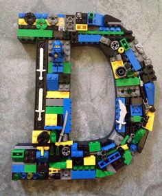 This is a made to order mosaic letter using genuine LEGO® bricks.   This is a example of a Letter D ! It is already sold!!  Colors of blues,