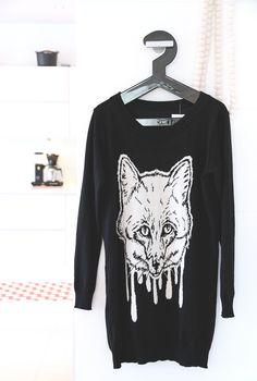 Uhana Design sweater on hanger
