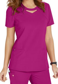 Let your Careisma shine! The Audrey keyhole top from Careisma by Sofia Vergara (in Hot Magenta) puts a cute and unique twist on the typical scrub top! This modern fit scrub top features roomy angled pockets and a removable wristlet inside the right pocket.