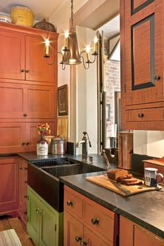 Owners Steve and Devona Porter have meticulously restored the ca. 1840 Tucker House in Louisville, Kentucky, which they run as a bed-and-breakfast inn. Stone sinks are a beautiful complement to early American homes; this one has a faucet reminiscent of a pump. Cabinets have been faux grained with paint, a common decorating practice in the early 19th century. This kitchen, too, is by David T. Smith.