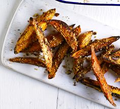 Coat chunky wedges of squash in a crispy, spicy coating of hazelnuts, coriander seeds, sesame seeds and cumin and oven bake until tender Bbc Good Food Recipes, New Recipes, Cooking Recipes, Favorite Recipes, Cooking Ideas, Squash Fries, Healthy Snacks, Recipes, Appetizers