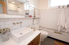 Love this classic, clean bathroom. Subway tiles and marble counter with basin sink.