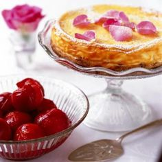 Lemon and orange cheesecake served with plums in port