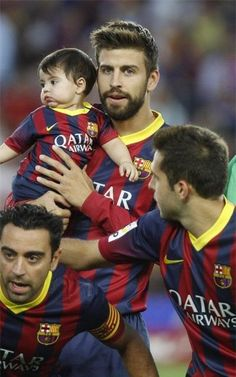 Gerard Pique of FC Barcelona is seen with his son Milan prior to the La Liga match between FC Barcelona and Sevilla FC at Camp Nou on Septem...