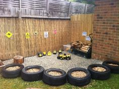 add some plants in the tires and it would be a cheap cool border around the kids play area. Outdoor play areas Themed Backyard Play — All for the Boys Kids Outdoor Play, Outdoor Play Spaces, Kids Play Area, Backyard For Kids, Outdoor Fun, Children Play, Outdoor Games, Outdoor Car Track For Kids, Eyfs Outdoor Area Ideas