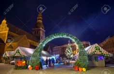 RIGA, LATVIA - DECEMBER 20, 2015: People Visit Christmas Fair.. Stock Photo, Picture And Royalty Free Image. Image 50974405.