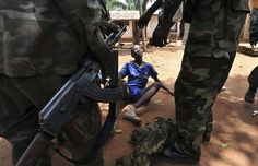 Sia Kambou / AFP - Getty Images Rebels of the Seleka coalition arrest a man, who was wearing military fatigues and claiming to belong to the Seleka movement, suspected of looting a house in Bangui, Central African Republic, on March 26, 2013.
