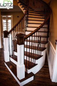 Who doesn't enjoy seeing a dramatic staircase in their foyer?  This blog post explains how to stain your staircase treads a contrasting color to the stair risers.  Current trends also are to take out the outdated wood spindles, and install metal bannisters.  Give us a call. We can do all of this for you.