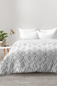 RosebudStudio Stay in bed Comforter | DENY Designs Home Accessories