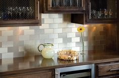 a metallic backsplash adds a contemporary touch to the