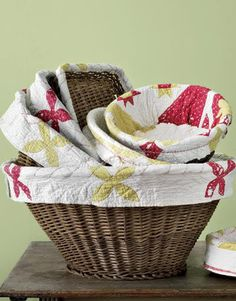 you can get basket soo cheap at goodwill and just line the inside with cute fabric.