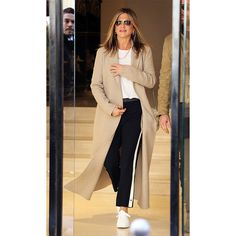 Jen Aniston - Athleisure has gotten a bad rap lately, frequently associated with mesh leggings and micro bra tops. In fact, the essence of the trend, elevated sportswear that can be worn beyond the gym, is decidedly polished. Take a cue from Jen Aniston and pair striped track trousers with a white tee, sneakers and a longline jacket.