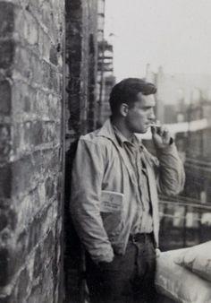 """""""Jack Kerouac, railroad brakeman's rule-book in pocket...206 East 7th Street near Tompkins Park, Manhattan, probably September 1953.""""  Photograph and quote by Allen Ginsburg"""