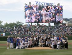 The Chicago Cubs and Blackhawks pose for a photo Tuesday with the Stanley Cup on the pitcher's mound.