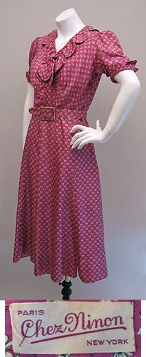 Silk twill day dress fom the mid-30s. Fabulous raspberry pink colour with tiny black & white bow print.