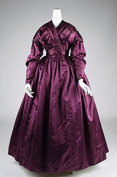 Deep purple satin gown (circa 1840)    The Metropolitan Museum of Art.  Full, gathered skirt and tightly cinched waistline.  The overlapping bodice has a pleated trim instead of a collar.  Drop-shoulders and long sleeves are classic elements of this time.  Minimal ornamentation.
