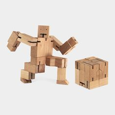 Cubebot    With a fun design inspired by Japanese Kumi-ki puzzles, Cubebot is a toy robot made of a durable hardwood frame and limbs with elastic-band muscles to hold poses. A challenging puzzle, it also folds into a cube. Made of sustainably harvested cherry wood and elastic bands. Ages 3 and up.
