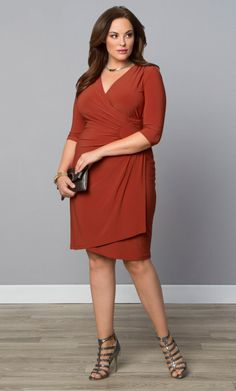 Turn up the basics with our Ciara Cinch Dress. This classic faux wrap style has been given a unique inset detail that gives this beautifully simple pull over dress a little something extra. The inset helps pull the eye to the smallest part of your body while creating a lovely drape and ruching across your stomach to flatter. You will feel comfortable and confident with the double lining and flattering thick material that stretches and breathes. Available exclusively in women's plus sizes…