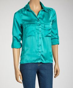 Get a basic look with a feminine flair. This smart button-up top combines a tailored look with an eye-catching sateen fabric.